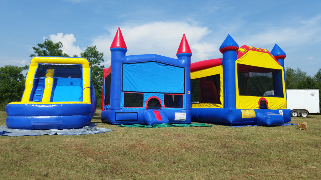 Red and Blue Bounce House, 3 in 1 combo bounce house, and 12 foot wet/dry slide at an outdoor party in North Carolina